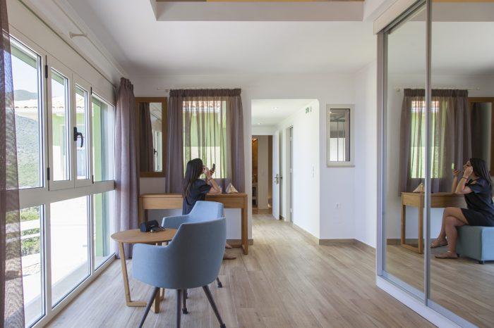 villa-cohili-sivota-lefkada-greece-bedroom-spacious-area-with-modern-furniture-private-balcony