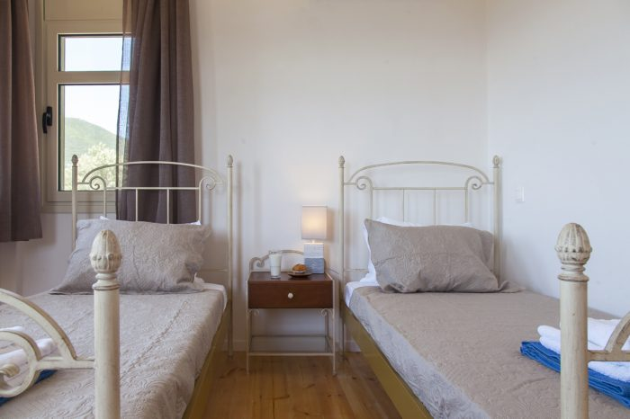 villa-cohili-sivota-lefkada-greece-bedroom-with-two-signle-beds-modern-decoration