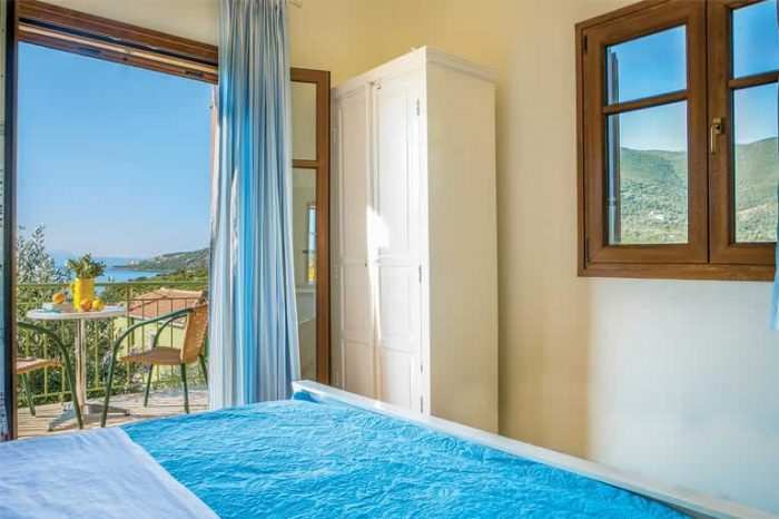villa-maistro-sivota-villas-lefkada-greece-bedroom-with-private-balcony-seaviews