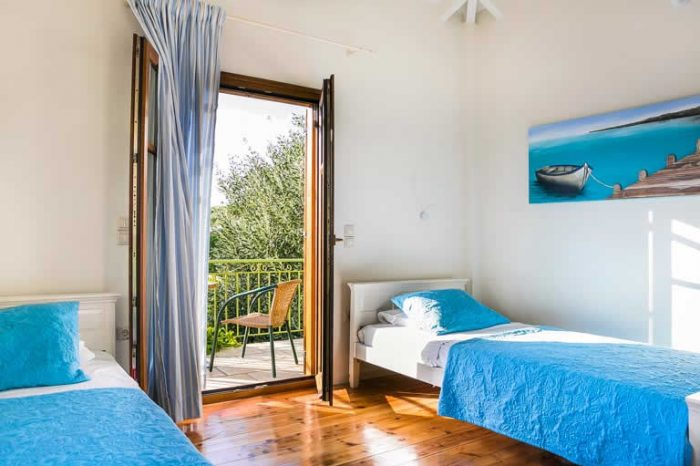 villa-ostria-lefkada-greece-modern-twin-bedroom-with-two-single-beds