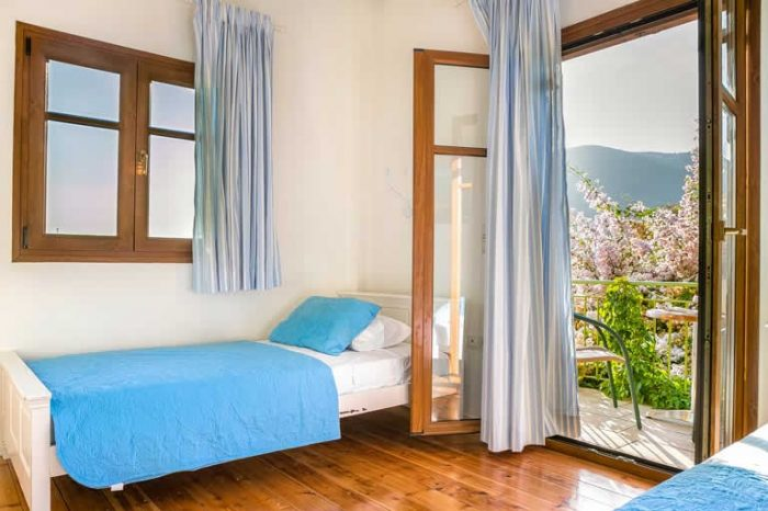 villa-ostria-sivota-villas-lefkada-greece-bedroom-with-two-single-beds