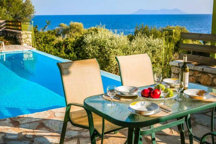 villa-ostria-sivota-villas-lefkada-greece-private-pool-outdoor-dining-area-panoramic-views
